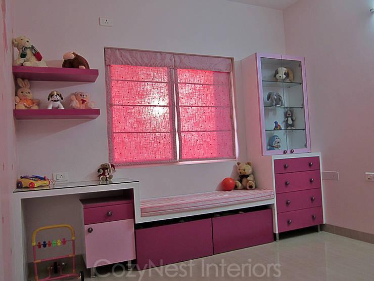 Ramamoorthy Residence:  Nursery/kid's room by Cozy Nest Interiors