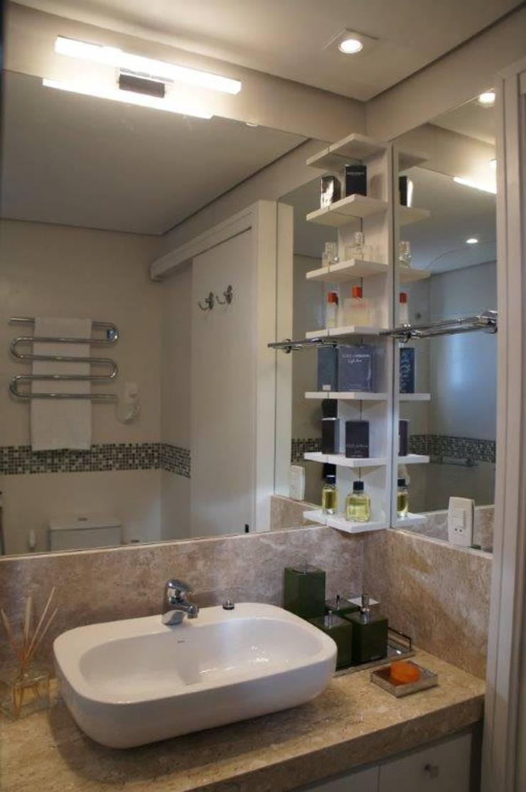 Utilização de espelhos para melhorar a sensação interna :   por Triple Arquitetura,Moderno