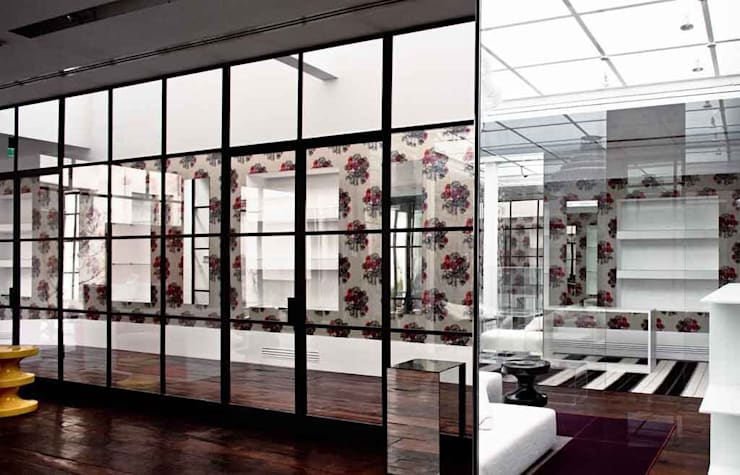 Retails: Negozi & Locali commerciali in stile  di SILVIA MASSA STUDIO