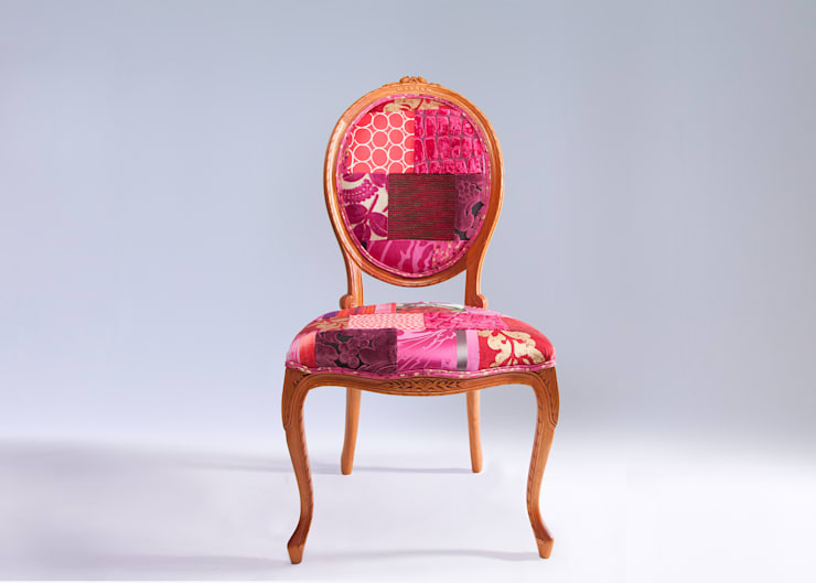 Oval backed luxury patchwork dining chair in reds:  Dining room by Suzy Newton Ltd.