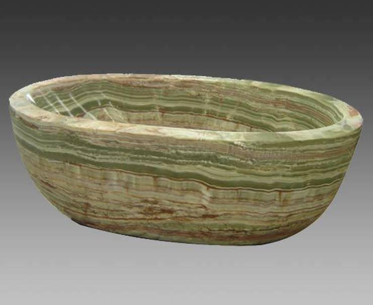 stone bath tub:  Bathroom by Anzalna Trading Company