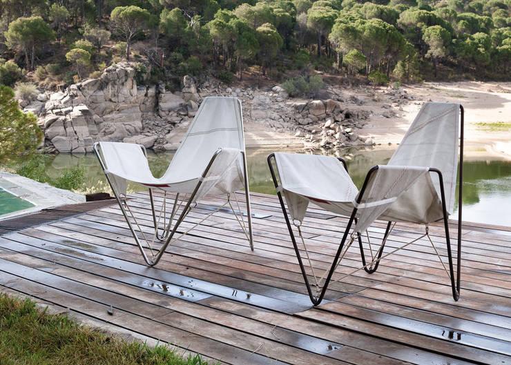 TRIMMER: Balcones y terrazas de estilo  de DVELAS