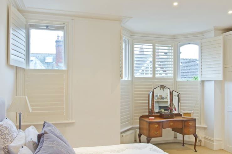 Tier on Tier Shutters for Sash & Bay Windows:  Windows & doors  by Plantation Shutters Ltd