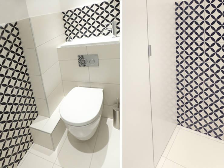 A SAINT GERMAIN DES PRES: Salle de bains de style  par EC Architecture Intérieure