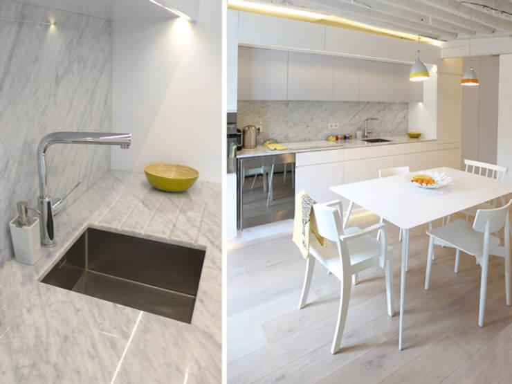 A SAINT GERMAIN DES PRES: Cuisine de style  par EC Architecture Intérieure