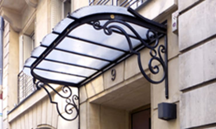 UN HOTEL A OPERA: Hôtels de style  par EC Architecture Intérieure
