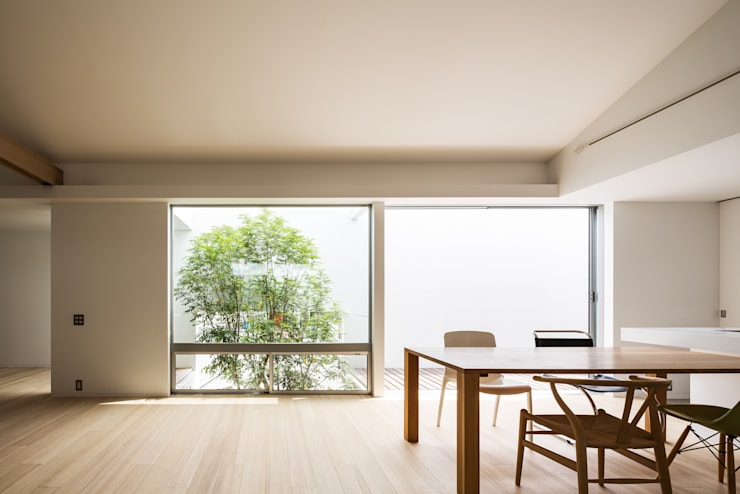Salas de jantar modernas por Kenji Yanagawa Architect and Associates