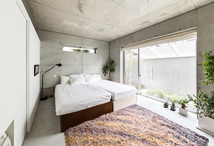 Quartos modernos por Kenji Yanagawa Architect and Associates
