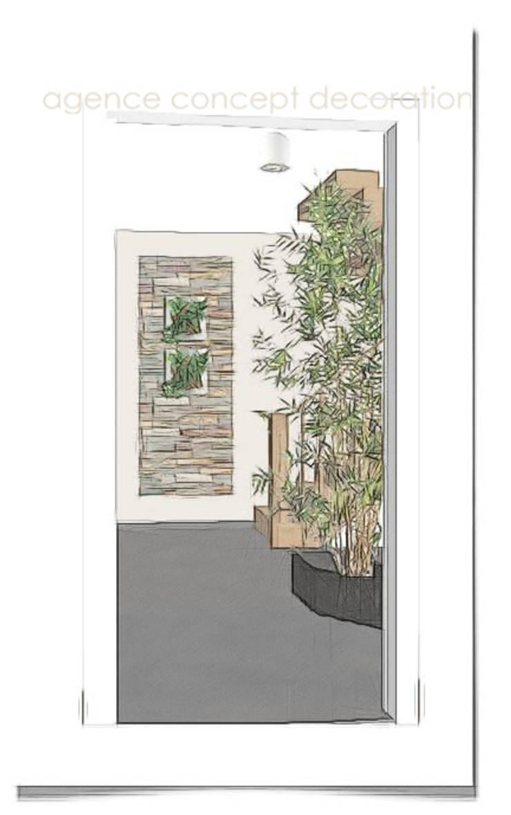 agencement entrée: Salon de style  par agence concept decoration