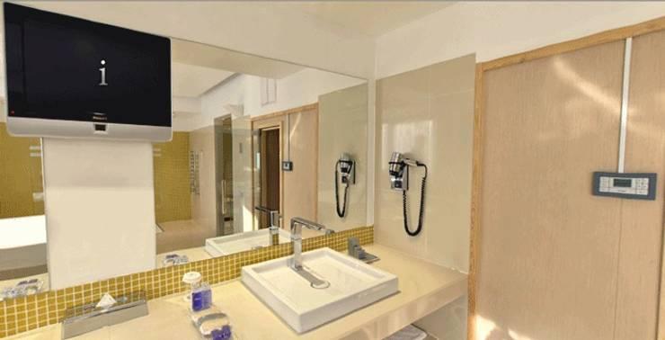 The Dostyk Hotel: Baños de estilo  de TONO BAGNO   Pasión por tu baño