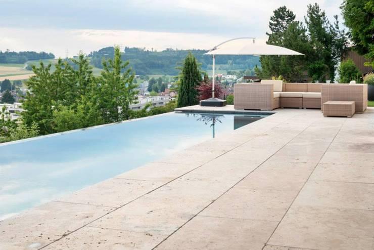Sunset:  Pool von Marty Häuser AG