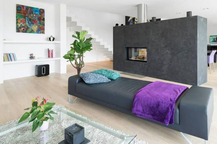 Sunset:  Wohnzimmer von Marty Häuser AG