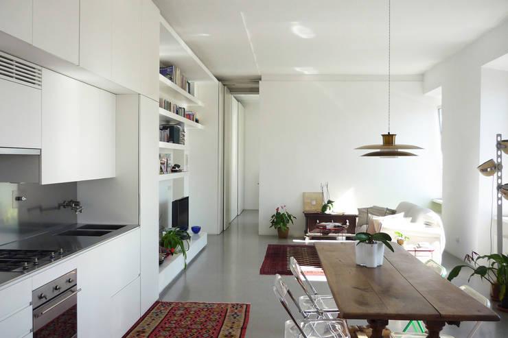 Casa Gazometro: Casa in stile  di maria adele savioli architettura,