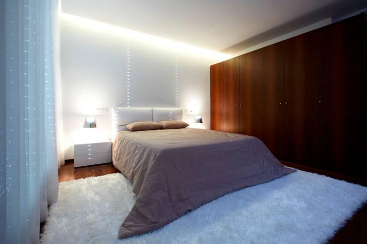 Suite Augusta House: Quartos  por Risco Singular - Arquitectura Lda