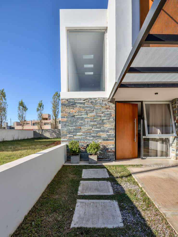 CASAS ADOSADAS: Casas de estilo  por Estudio A+3