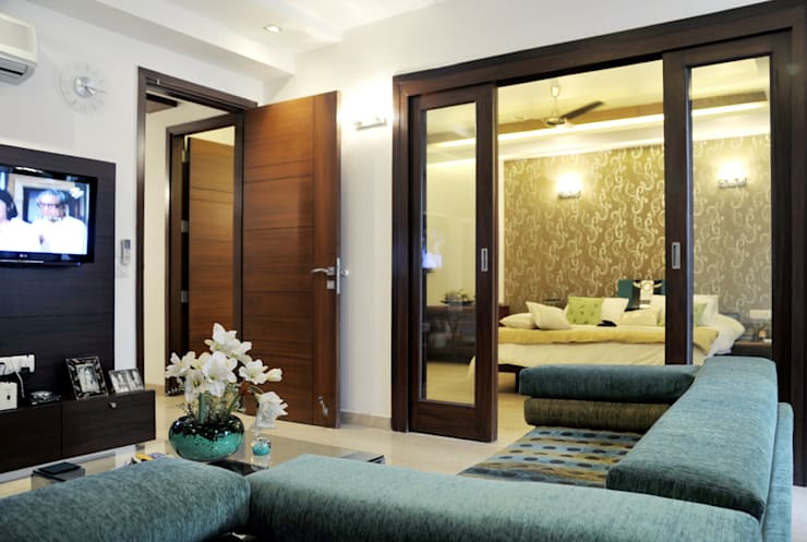 Residential Projects:  Living room by Vijay Kapur Designs