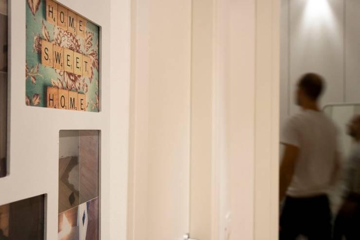 """<q class=""""-first"""">CASET'TINA</q> CONVERSIONE DA UFFICIO AD APPARTAMENTO RESIDENZIALE. COMPLETA RIQUALIFICAZIONE INTERNA.: Case in stile  di Ferretti Studio"""