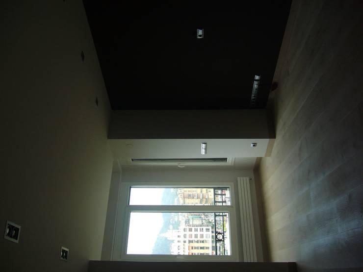Reforma y división de viviendas: Casas de estilo  de ilj arquitectura