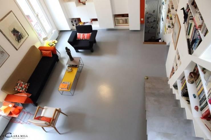 Espace Salon: Maisons de style  par Galaktik