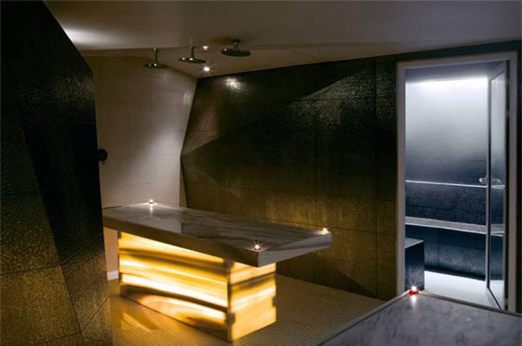 Table de soins: Espaces commerciaux de style  par Galaktik