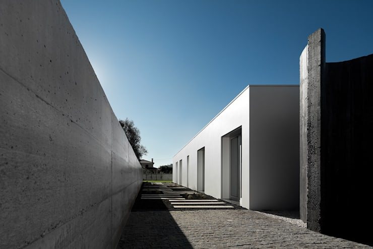 Casas de estilo  por A2+ ARQUITECTOS