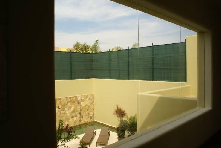 Casa K Jardines minimalistas de arqflores / architect Minimalista