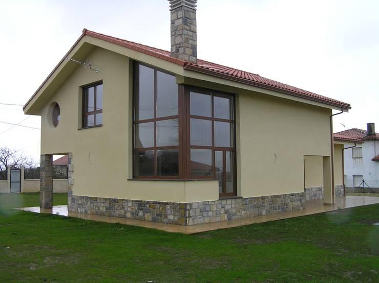 VIVIENDA SAN MIGUEL:  de estilo  de Agora Arquitectos