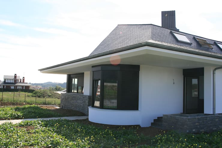 Vivienda Unifamiliar en Berango:  de estilo  de Alonso Saezmiera & González Ayo Arquitectos Asociados S.L.P.