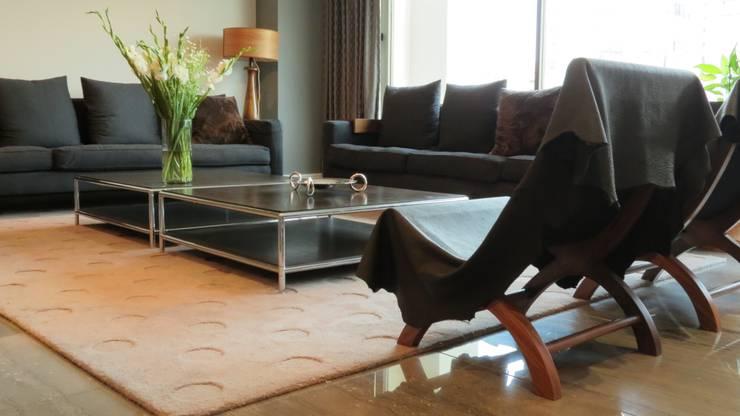 T801 06: Salas de estilo  por NIVEL TRES ARQUITECTURA