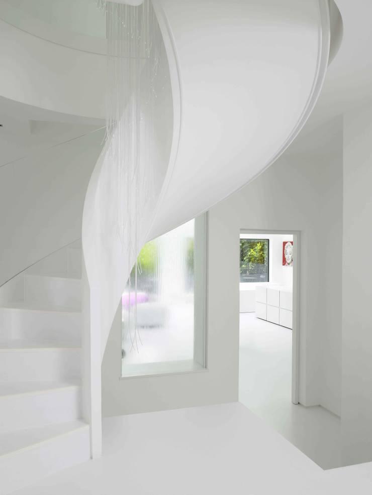 Ice White House-Luxury home:  Corridor & hallway by Quirke McNamara