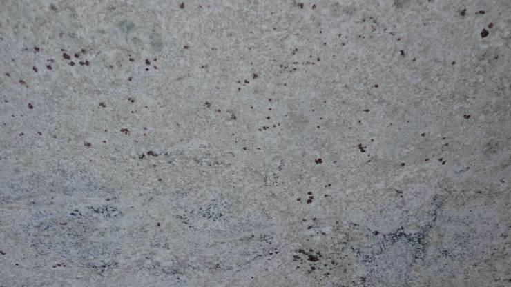 Granito Blanco Romano: Paredes y pisos de estilo  por Marmoles Continentales
