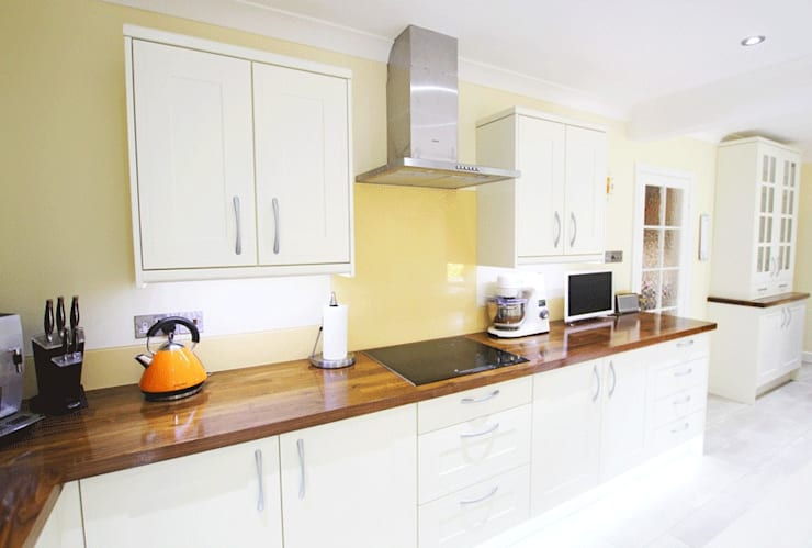 White Kitchen Units With Orange Accents:  Kitchen by Rebecca Coulby Interiors
