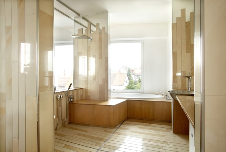 Baños de estilo  de c.f.Architekten