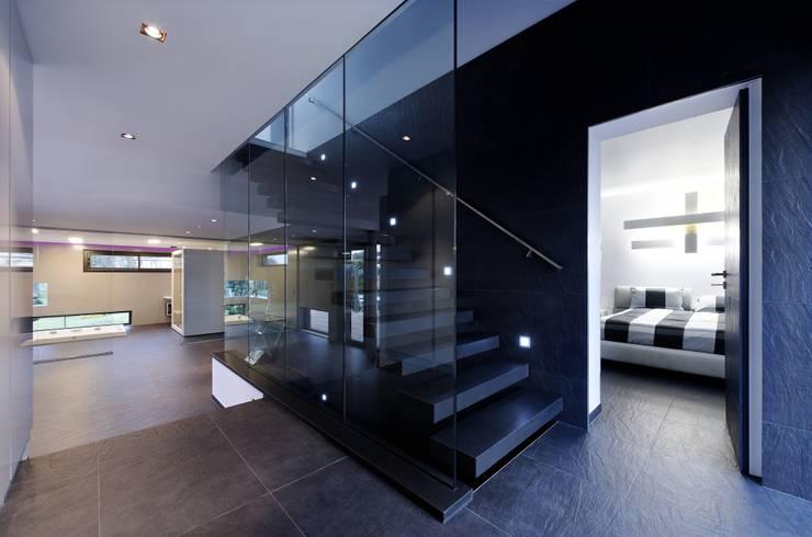 VILLA D: Maisons de style de style Moderne par IDEAA