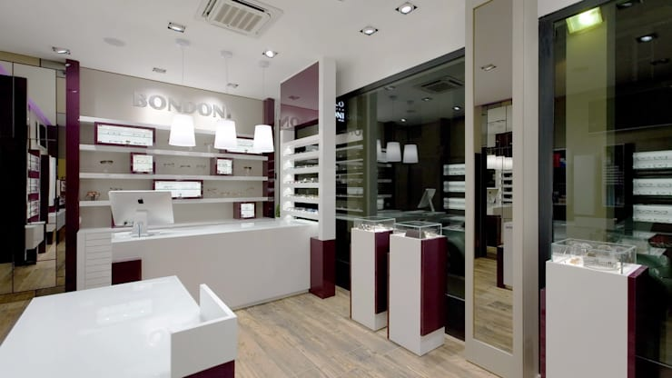 Ottica BONDONI, Magenta (MI) Italy: Negozi & Locali commerciali in stile  di ARKETIPO DESIGN