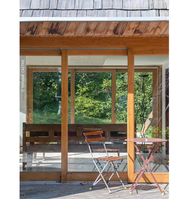 transparence Est-Ouest: Maisons de style  par Jean-Charles CASTRIC - architecte D.P.L.G.