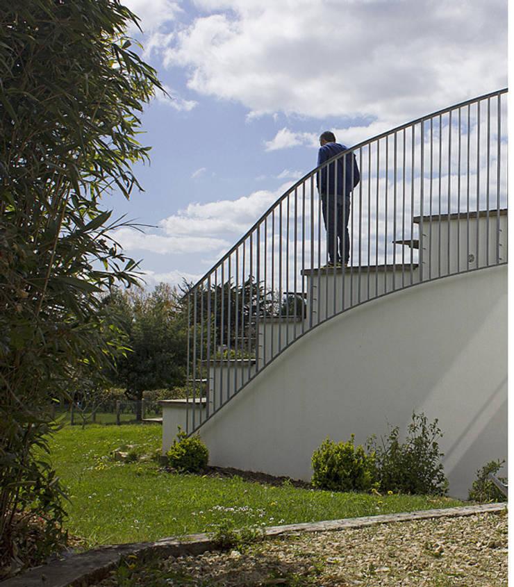Bord Est: Maisons de style  par Jean-Charles CASTRIC - architecte D.P.L.G.