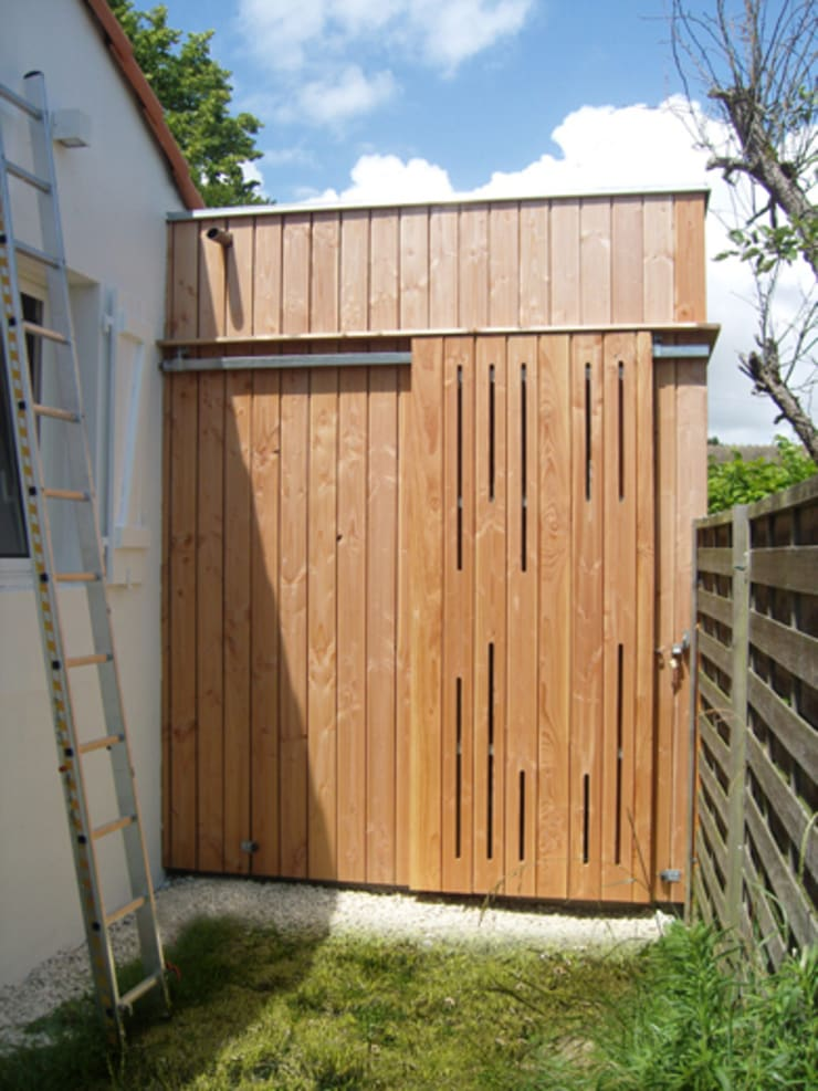 Extension en bois - façade coulissante: Maisons de style  par MXC ARCHITECTES