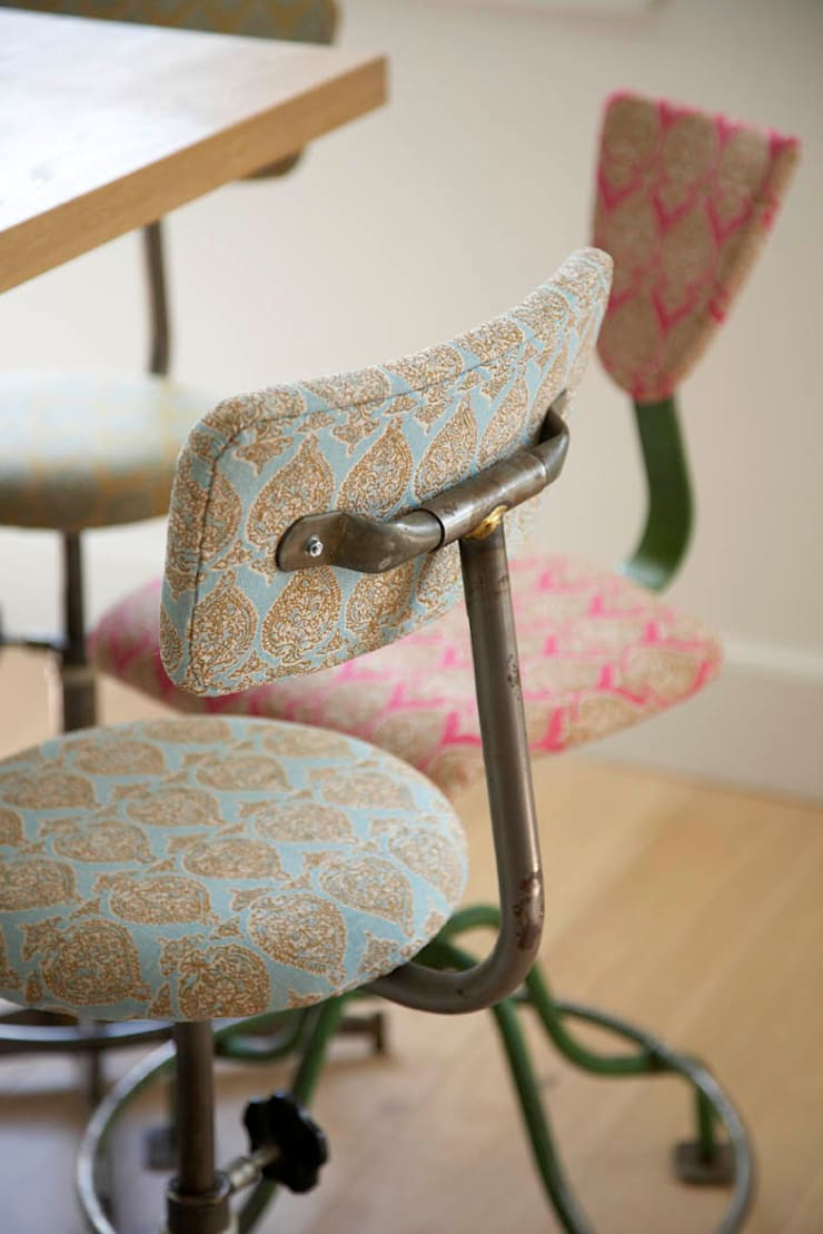 Vintage stools with colourful upholstery: eclectic Kitchen by Concept Interior Design & Decoration Ltd