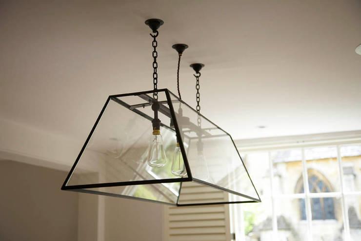 Bespoke glass carriage light: classic Living room by Concept Interior Design & Decoration Ltd
