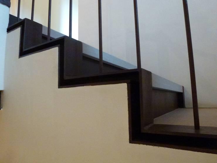 House F+C interior: Case in stile  di Franzoni Studio