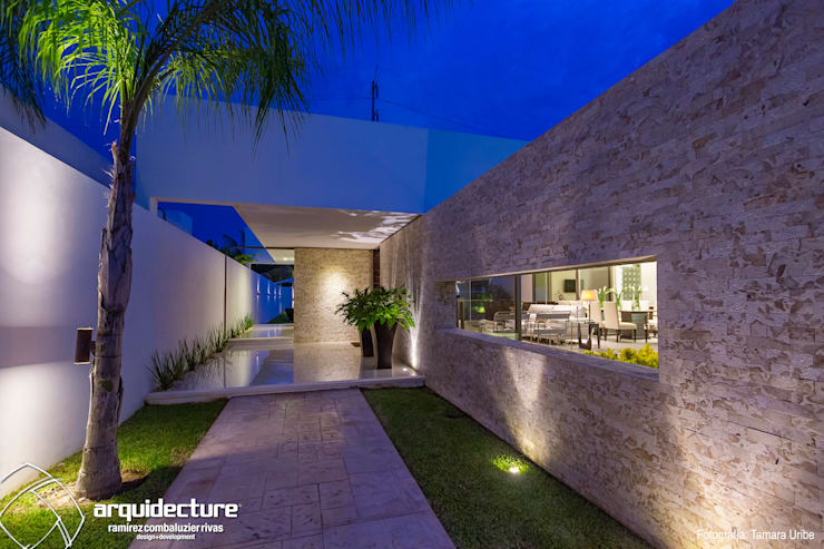 Casa Kopché: Casas unifamiliares de estilo  por Grupo Arquidecture, Moderno Piedra