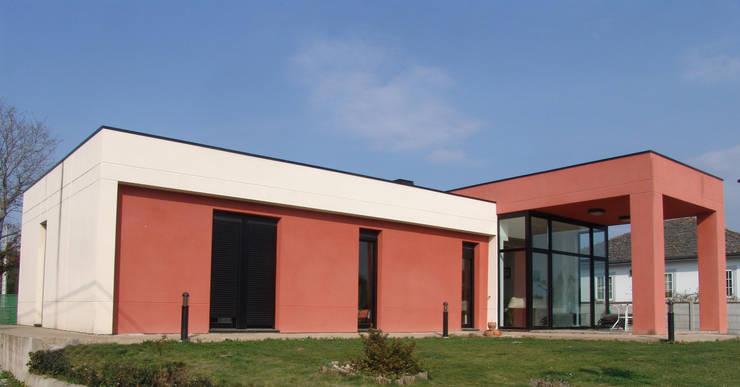 Casas de estilo  por KM Arquitectos