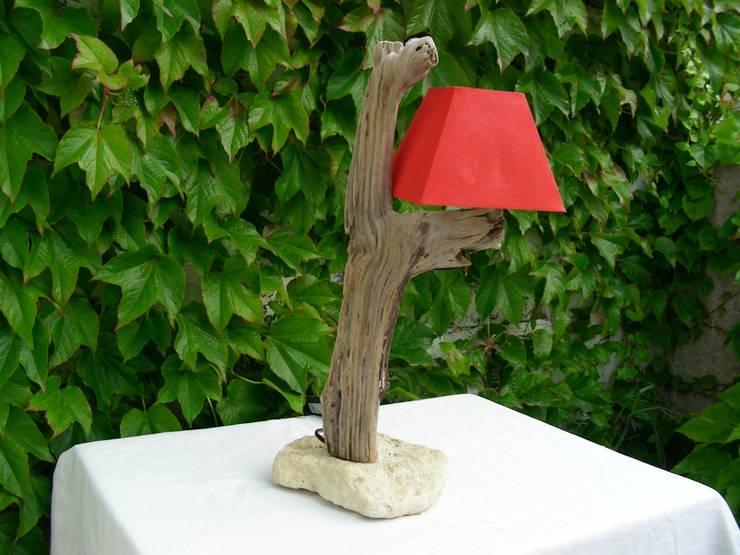 décoration en bois flotté: Salon de style  par Bois flotté de Gibus