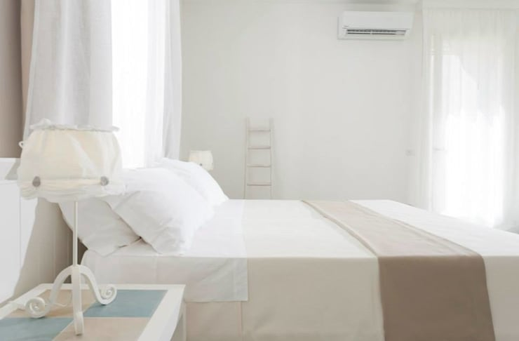 Podere40: Hotel in stile  di UZone Design,