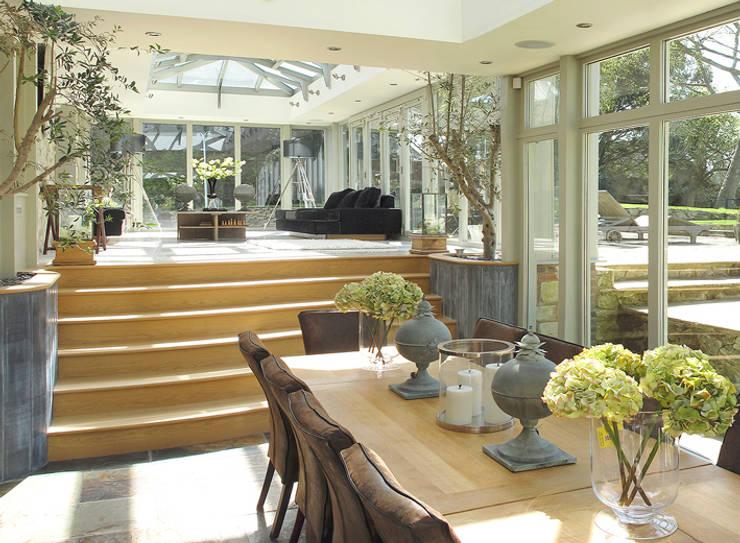 Orangery in Surrey:  Kitchen by Clifford Interiors