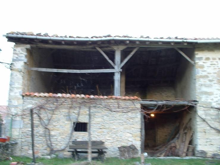 Rehabilitación de caserío en Urbina: Casas de estilo  de EM_DEPLO