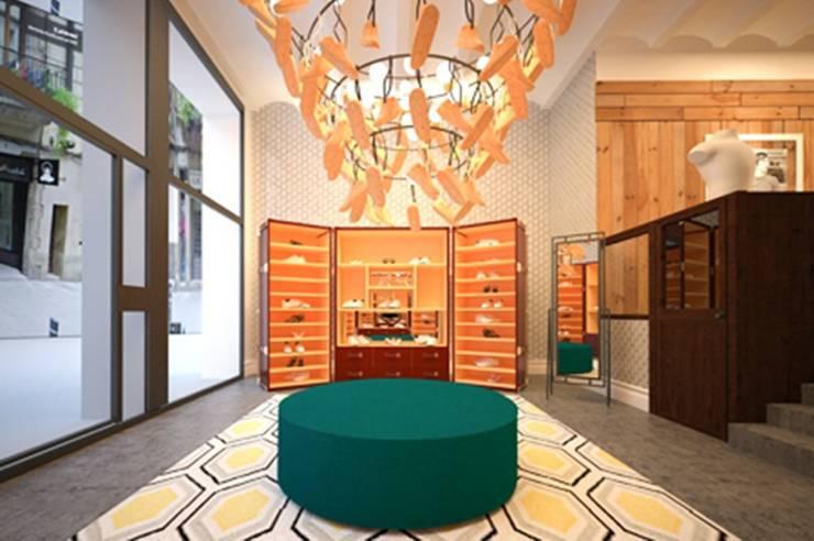 THE CRUYFF STORE: Oficinas y Tiendas de estilo  de Piedra Papel Tijera Interiorismo