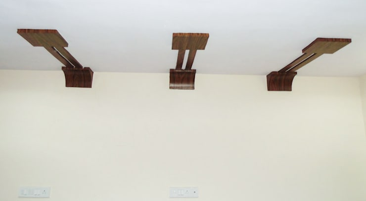 Wooden Films on Plaster of Paris Ceiling with Designer Effect:  Office spaces & stores  by Krishna Equytech