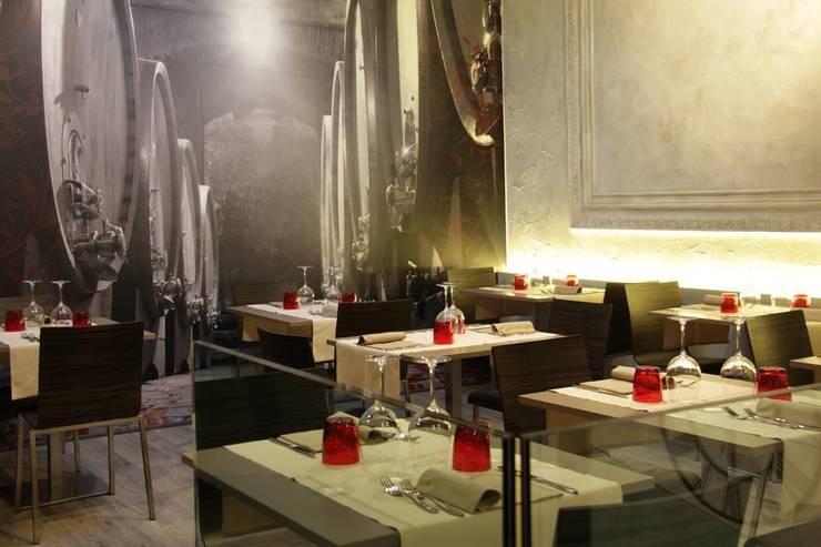 ferro crudo ristorante:  in stile  di Studio Lunardi